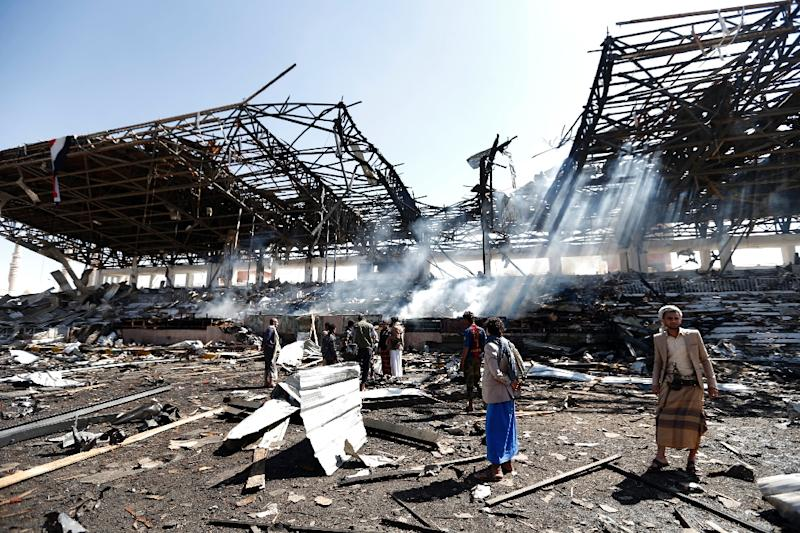 Yemeni men inspect the site of an air strike in the capital Sanaa, on November 5, 2017