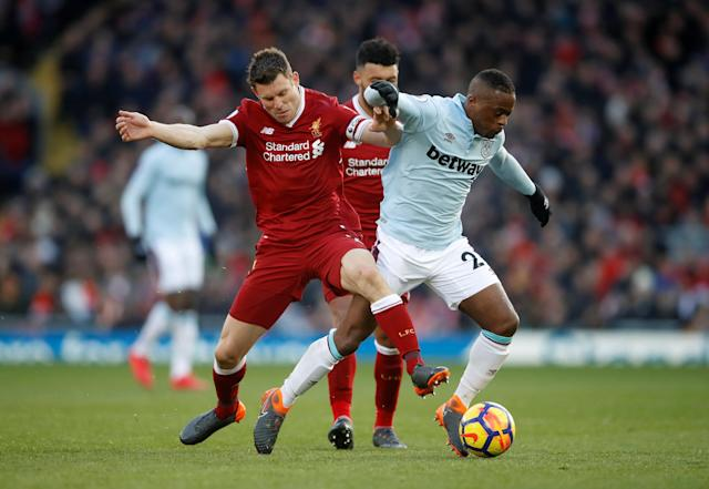 """Soccer Football - Premier League - Liverpool vs West Ham United - Anfield, Liverpool, Britain - February 24, 2018 Liverpool's James Milner in action with West Ham United's Patrice Evra Action Images via Reuters/Carl Recine EDITORIAL USE ONLY. No use with unauthorized audio, video, data, fixture lists, club/league logos or """"live"""" services. Online in-match use limited to 75 images, no video emulation. No use in betting, games or single club/league/player publications. Please contact your account representative for further details."""
