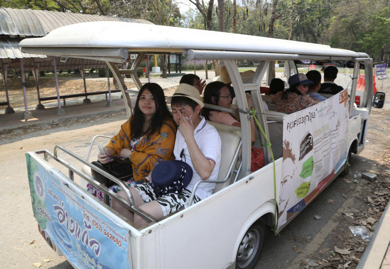 "In this March 30, 2014 photo, Chinese tourists ride on a cart while touring Chiang Mai University in Chiang Mai province, northern Thailand. The bucolic, once laid-back campus of one of Thailand's top universities is under a security clampdown. Not against a terrorist threat, but against Chinese tourists. Thousands have clambered aboard student buses at the university, made a mess in cafeterias and sneaked into classes to attend lectures. Someone even pitched a tent by a picturesque lake. The reason: ""Lost in Thailand,"" 2012 slapstick comedy partly shot on campus that is China's highest-grossing homegrown movie ever. (AP Photo/Apichart Weerawong) (AP Photo/Apichart Weerawong)"