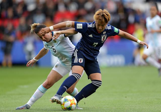 Aldana Cometti of Argentina battles for possession with Yuki Sugasawa of Japan during the 2019 FIFA Women's World Cup France group D match between Argentina and Japan at Parc des Princes on June 10, 2019 in Paris, France. (Photo by Richard Heathcote/Getty Images)
