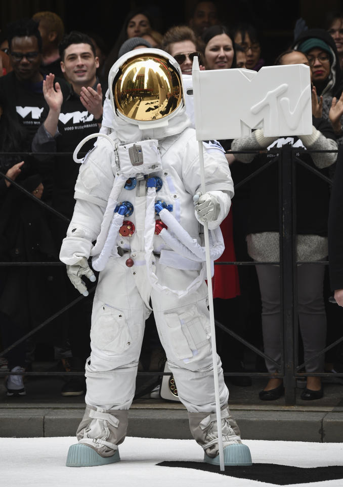 """The VMA """"Moon Person"""" participates in the 2018 MTV Video Music Awards date and location announcement at Radio City Music Hall on Tuesday, April 17, 2018, in New York. The 2018 MTV VMAs' will air live on Monday, Aug. 20 from Radio City Music Hall. (Photo by Evan Agostini/Invision/AP)"""