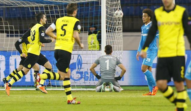 Zenit goalkeeper Yuri Lodygin, center, reacts after missing Borussia's second goal during the Champions League soccer match between Zenit St.Petersburg and Borussia Dortmund at Petrovsky stadium in St.Petersburg, Russia, on Tuesday, Feb. 25, 2014. (AP Photo/Dmitry Lovetsky)