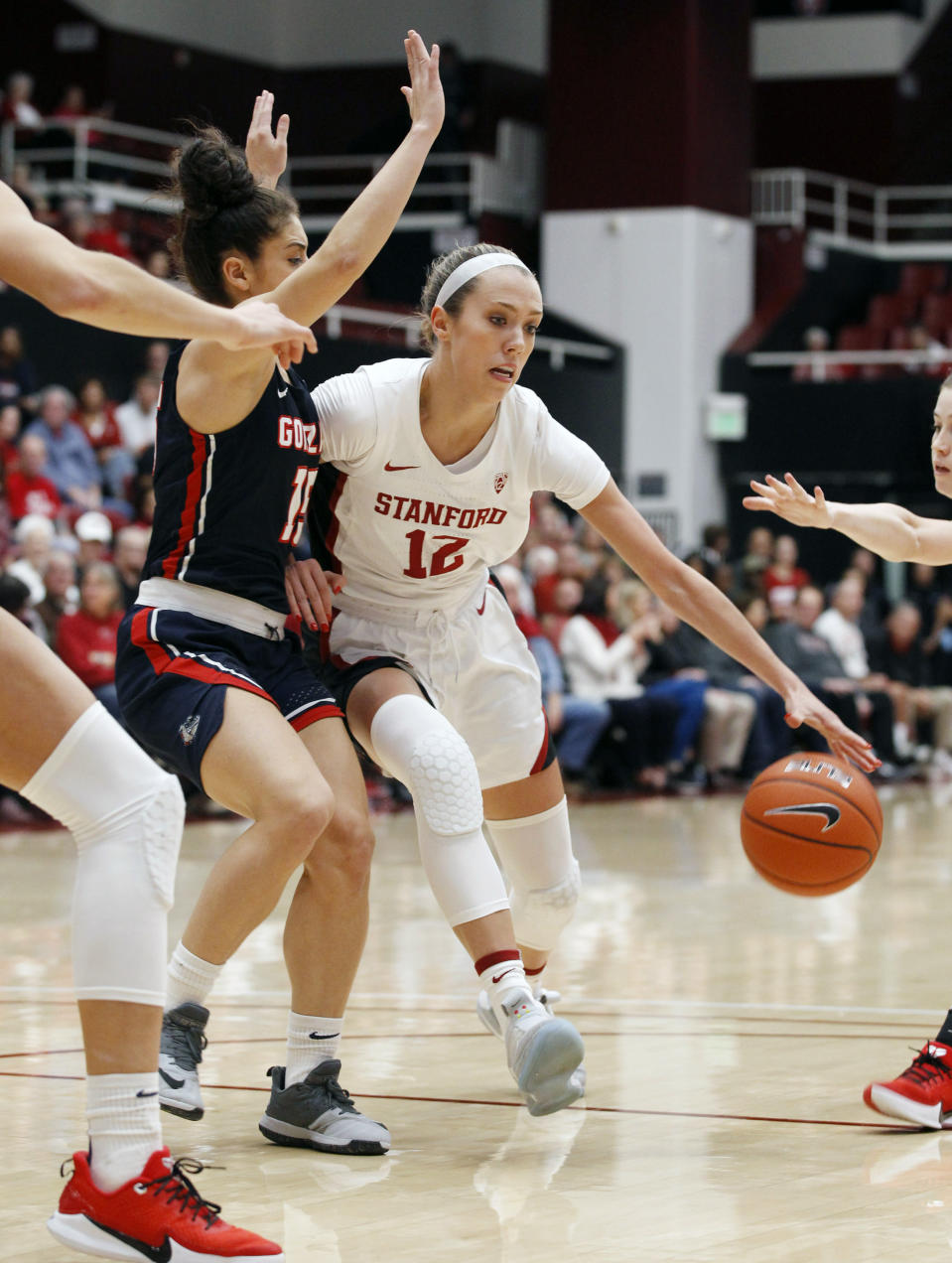 Stanford's Lexie Hull (12) drives for the basket as Gonzaga's Jessie Loera defends during the first half of an NCAA college basketball game Sunday, Nov. 17, 2019, in Stanford, Calif. (AP Photo/George Nikitin)