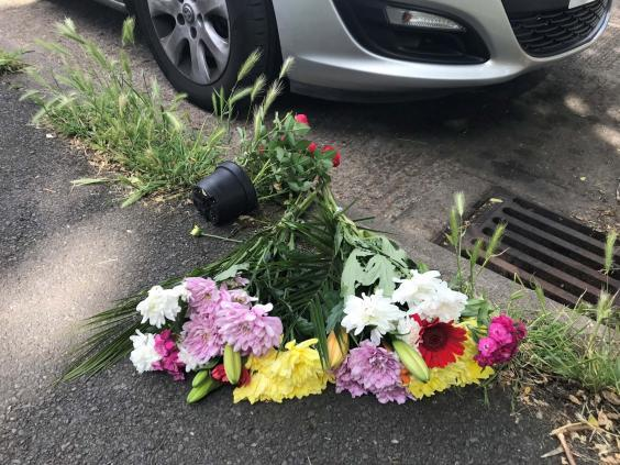 Flowers left near scene of fatal stabbing attack in Wandsworth (PA)