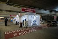 A temporary Emergency Room is built in a parking garage at Providence Cedars-Sinai Tarzana Medical Center in California as virus cases surge