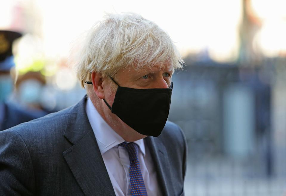 Britain's Prime Minister Boris Johnson wearing a protective face covering, arrives to attend a service marking the 80th anniversary of the Battle of Britain at Westminster Abbey in central London on September 20, 2020. - Westminster Abbey has played a central role in remembering the sacrifice of those who fought in the battle, holding a Service of Thanksgiving and Rededication on Battle of Britain Sunday every year since 1944. (Photo by Aaron Chown / POOL / AFP) (Photo by AARON CHOWN/POOL/AFP via Getty Images)