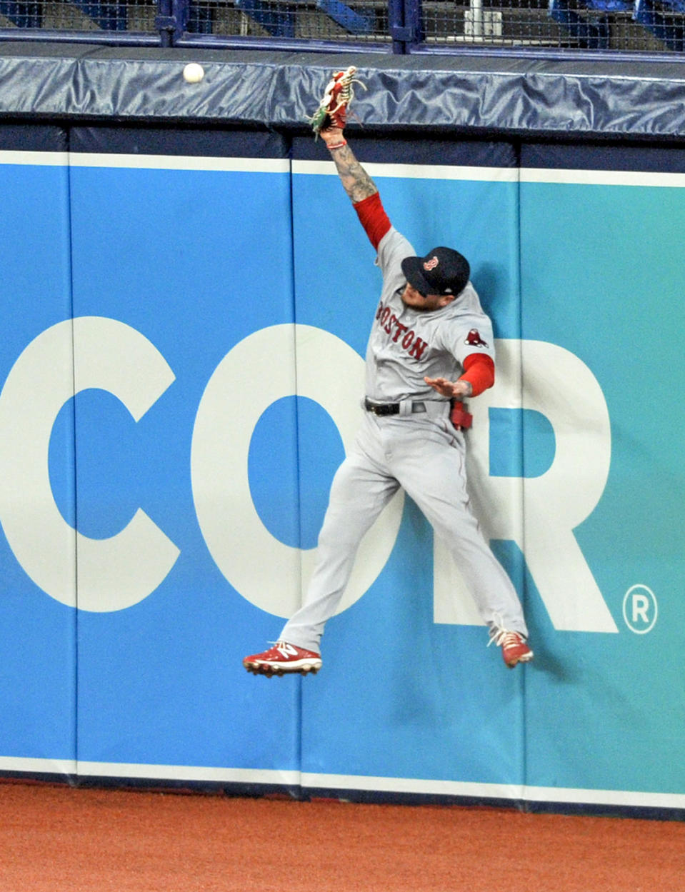 Boston Red Sox right fielder Alex Verdugo comes up short as he leaps for a double off the wall hit by Tampa Bay Rays' Yandy Diaz during the first inning of a baseball game Wednesday, Aug. 5, 2020, in St. Petersburg, Fla. (AP Photo/Steve Nesius)
