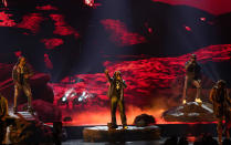 Quavo, from left, Takeoff and Offset, of Migos, perform at the BET Awards on Sunday, June 27, 2021, at the Microsoft Theater in Los Angeles. (AP Photo/Chris Pizzello)