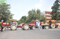 Bharatiya Kisan Union (BKU) members and Congress workers block the Ghaziabad-Hapur crossing with tractors to mark their protest against the agriculture reform bills passed by the Parliament, on September 25, 2020 in Ghaziabad, India. The two bills - the Farmers (Empowerment and Protection) Agreement on Price Assurance and Farm Services Bill, 2020 and the Farming Produce Trade and Commerce (Promotion and Facilitation) Bill, 2020 - were passed by the Rajya Sabha despite uproar and strong protest by the Opposition parties in the house. (Photo by Sakib Ali/Hindustan Times via Getty Images)