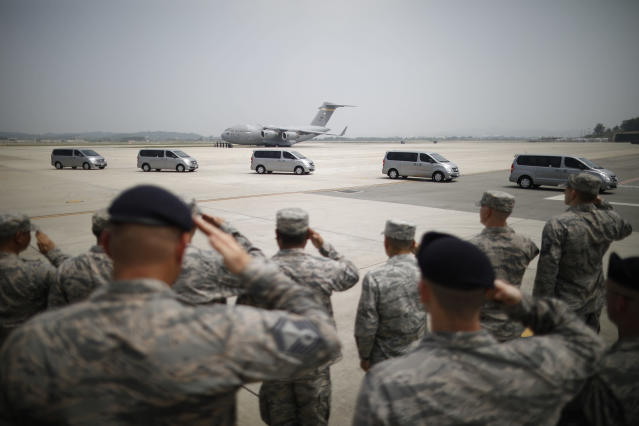 <p>U.S. soldiers salute to vehicles transporting the remains of 55 U.S. soldiers who were killed in the Korean War at Osan Air Base in Pyeongtaek, South Korea, Friday, July 27, 2018. (Photo: Kim Hong-Ji/Pool Photo via AP) </p>