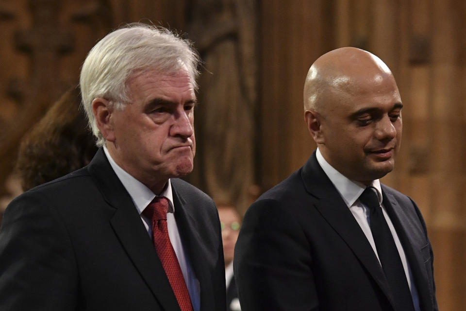 Chancellor of the Exchequer Sajid Javid (right) and Shadow chancellor John McDonnell in the Central Lobby as they walk back to the House of Commons after the Queen's Speech during the State Opening of Parliament ceremony in London.