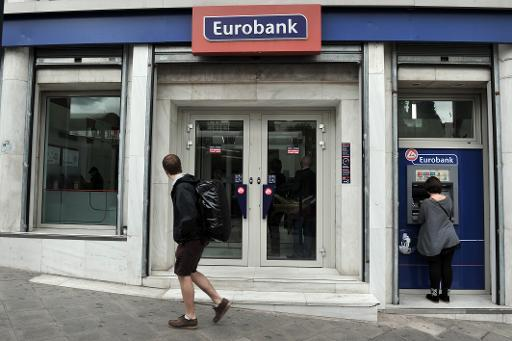 A man walks past an Eurobank's branch in central Athens on April 8, 2013