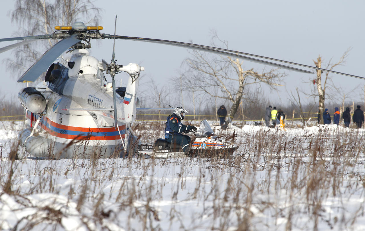 <p>Russian Emergency Situations Ministry employees and Russian police officers work at the scene of a AN-148 plane crash in Stepanovskoye village, about 40 kilometers (25 miles) from the Domodedovo airport, Russia, Feb. 12, 2018. (Photo: Alexander Zemlianichenko/AP) </p>