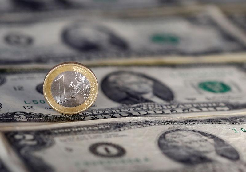 U.S. dollar note and a Euro coin are seen in this picture illustration