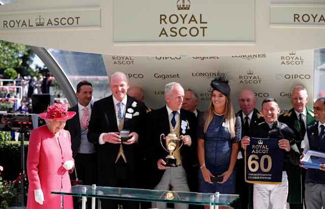 REFILE - CORRECTING TYPO Horse Racing - Royal Ascot - Ascot Racecourse, Ascot, Britain - June 21, 2018 Britain's Queen Elizabeth presents Frankie Dettori with a banner commemorating his 60th Royal Ascot win after he wins the Gold Cup riding Stradivarius Action Images via Reuters/Paul Childs