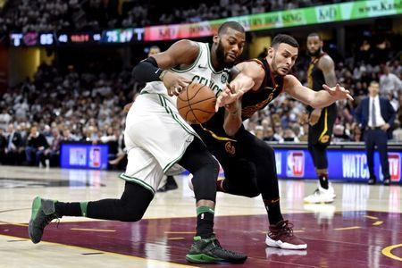 May 25, 2018; Cleveland, OH, USA; Cleveland Cavaliers forward Larry Nance Jr. (22) and Boston Celtics center Greg Monroe (55) go for the ball during the fourth quarter in game six of the Eastern conference finals of the 2018 NBA Playoffs at Quicken Loans Arena. Mandatory Credit: David Richard-USA TODAY Sports