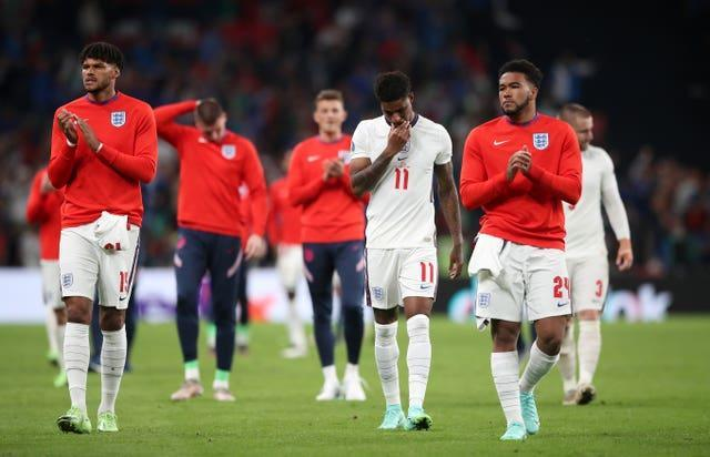 Tyrone Mings (left), Marcus Rashford and Reece James after the Euro 2020 final
