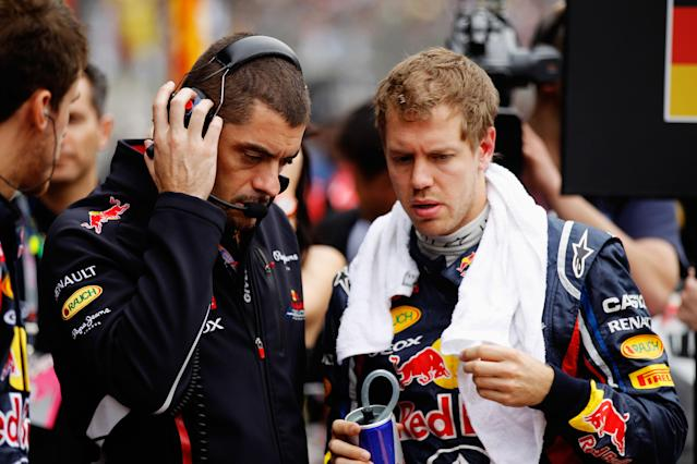 SHANGHAI, CHINA - APRIL 15: Sebastian Vettel (R) of Germany talks with his Red Bull Racing race engineer Guillaume Rocquelin (L) before the Chinese Formula One Grand Prix at the Shanghai International Circuit on April 15, 2012 in Shanghai, China. (Photo by Paul Gilham/Getty Images)