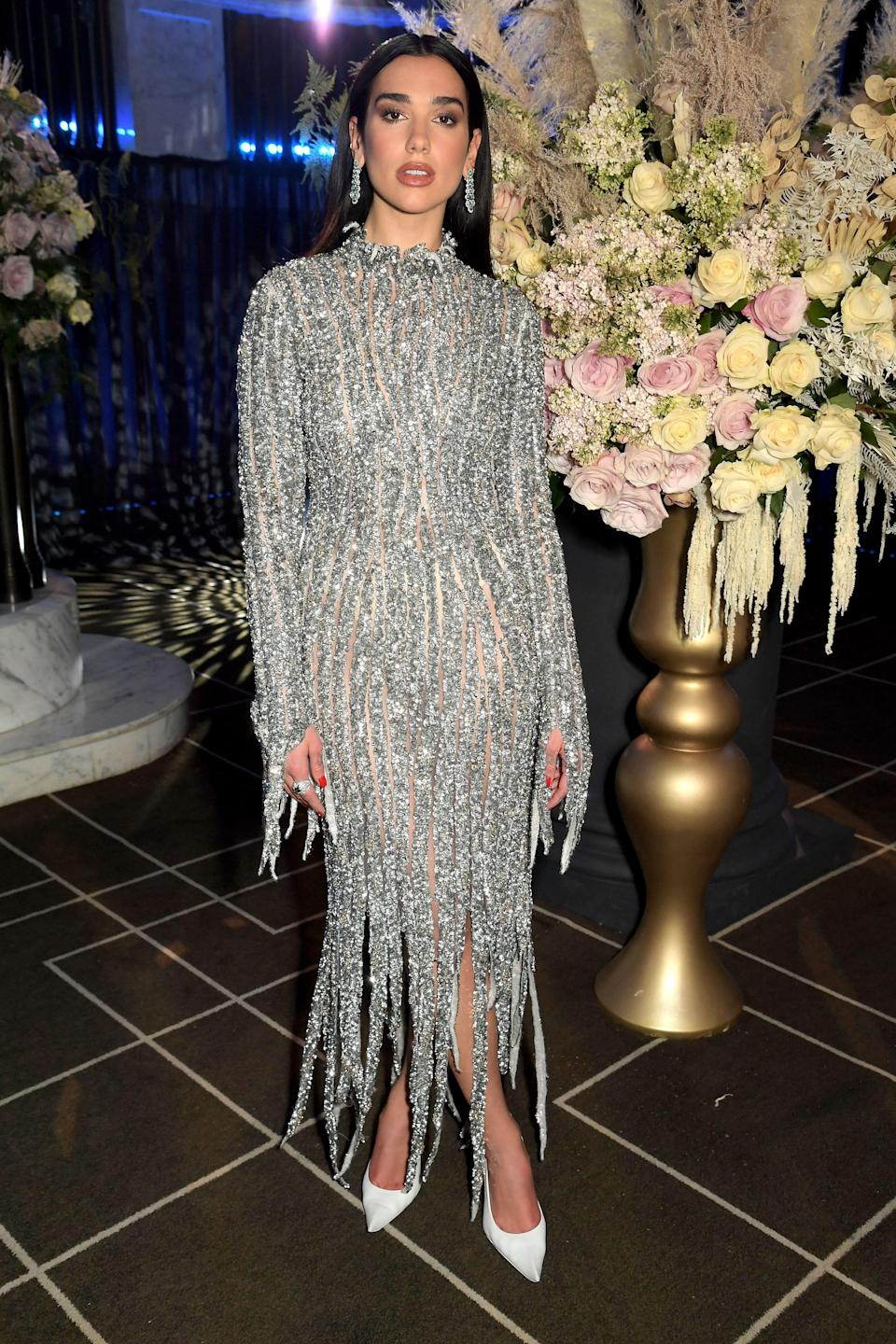 …and then this sparkling Balenciaga, both worn at Elton John's party. Two turtlenecks, both alike in dignity.