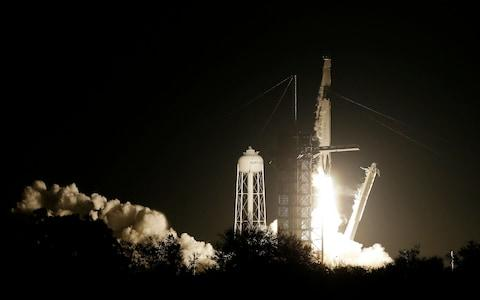 SpaceX Falcon 9 launch - Credit: AP Photo/Terry Renna