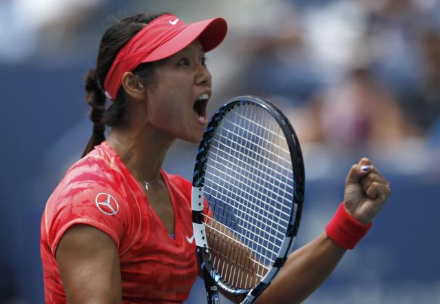 Li Na of China celebrate her victory over Laura Robson of Britain at the U.S. Open tennis championships in New York August 30, 2013. REUTERS/Eduardo Munoz (UNITED STATES - Tags: SPORT TENNIS)
