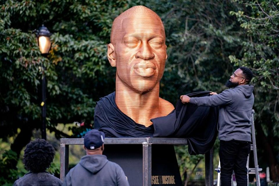 Floyd Statue Vandalized (Copyright 2021 The Associated Press. All rights reserved.)