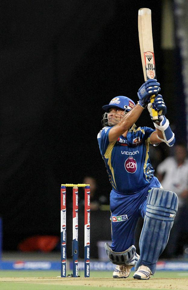 Mumbai Indian player Sachin Tendulkar plays a shot during match 37 of the Pepsi Indian Premier League ( IPL) 2013  between The Mumbai Indians and the Royal Challengers Bangalore held at the Wankhede Stadium in Mumbai on the 27th April 2013. (BCCI)