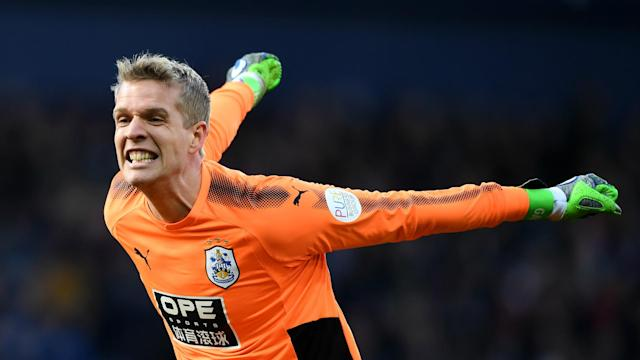 The Denmark keeper, who has kept eight Premier League clean sheets this season, has agreed a permanent move to the Terriers