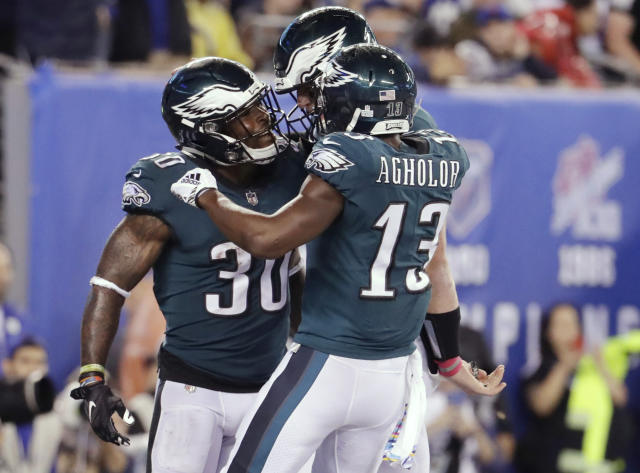 Philadelphia Eagles running back Corey Clement (30) celebrates with teammates Nelson Agholor (13) and Carson Wentz after rushing for a touchdown during the first half of an NFL football game against the New York Giants on Thursday, Oct. 11, 2018, in East Rutherford, N.J. (AP Photo/Julio Cortez)