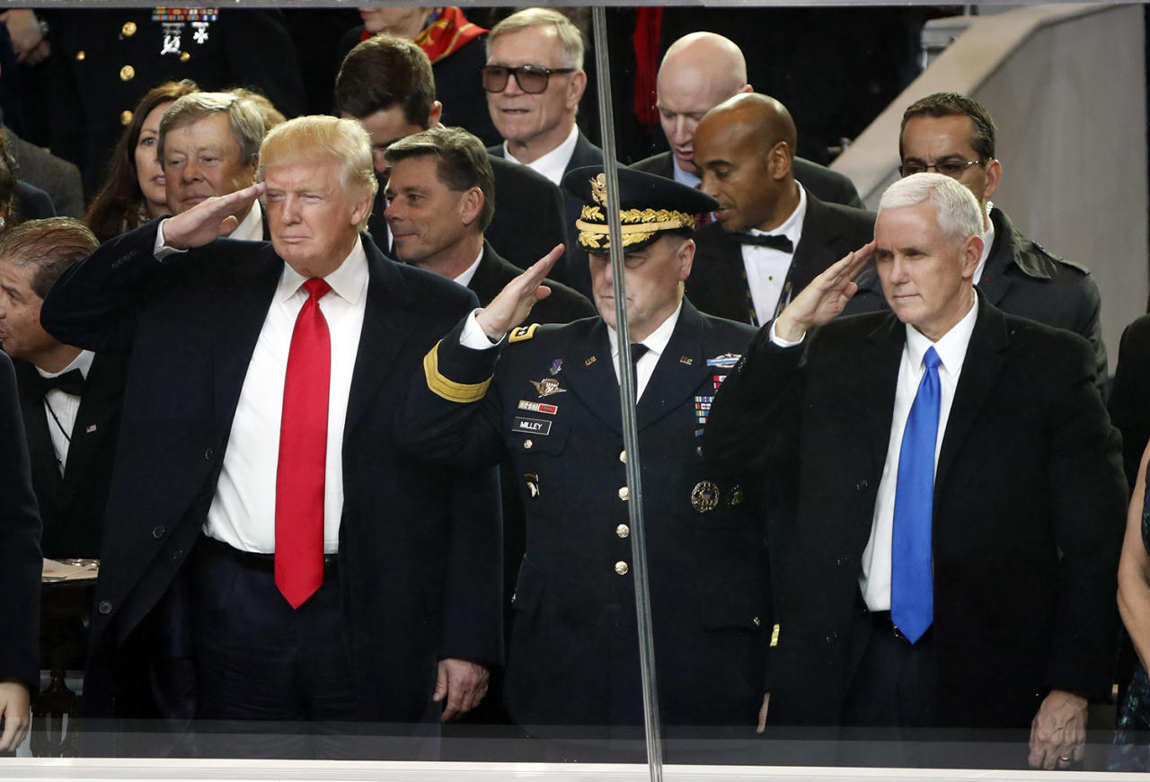<p>President Donald Trump salutes with Army Chief of Staff General Mark A. Milley and Vice President Mike Pence during the 58th Presidential Inauguration parade for President Donald Trump in Washington. Friday, Jan. 20, 2017 (Photo: Pablo Martinez Monsivais) </p>