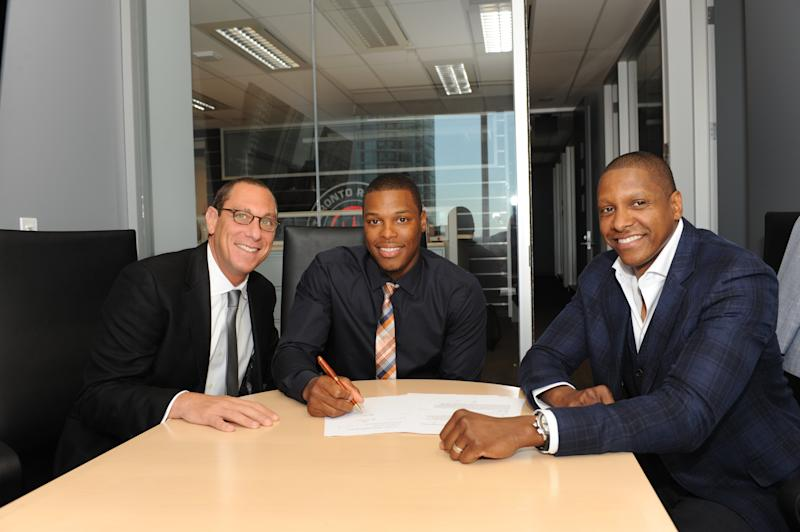 Andy Miller (left) negotiated more than $1 billion in contracts for Kyle Lowry (center) and scores of other NBA players. Now, he's had his certification as an agent revoked. (Getty)