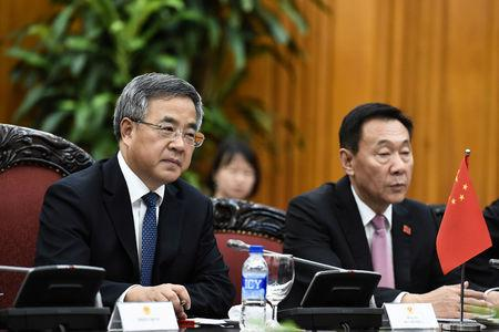 Chinese Vice Premier Hu Chunhua talks with Vietnamese Prime Minister Nguyen Xuan Phuc during their meeting at the government office in Hanoi
