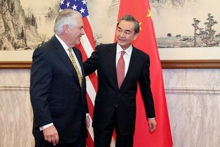 Chinese Foreign Minister Wang Yi talks with U.S. Secretary of State Rex Tillerson at Diaoyutai State Guesthouse on March 18, 2017 in Beijing