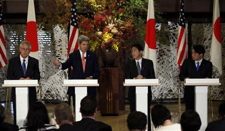 U.S. Secretary of State Kerry, Secretary of Defense Hagel, Japan's Defense Minister Onodera and Foreign Minister Kishida hold joint news conference at the Japan-U.S. Security Consultative Committee meeting in Tokyo