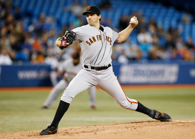 FILE PHOTO: San Francisco Giants' Zito pitches to Toronto Blue Jays during MLB American League baseball game in Toronto