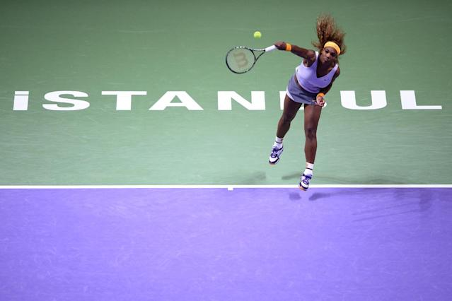 Serena Williams of the USA returns a shot to Jelena Jankovic of Serbia during their semifinal tennis match at the WTA Championship in Istanbul, Turkey, Saturday, Oct. 26, 2013. (AP Photo)