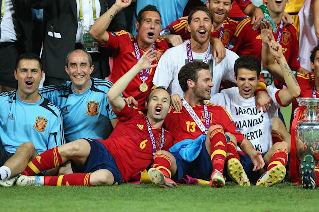 KIEV, UKRAINE - JULY 01: (L-R) Andres Iniesta, Juan Mata and Cesc Fabregas of Spain celebrate their victory after the UEFA EURO 2012 final match between Spain and Italy at the Olympic Stadium on July 1, 2012 in Kiev, Ukraine. (Photo by Handout/UEFA via Getty Images)