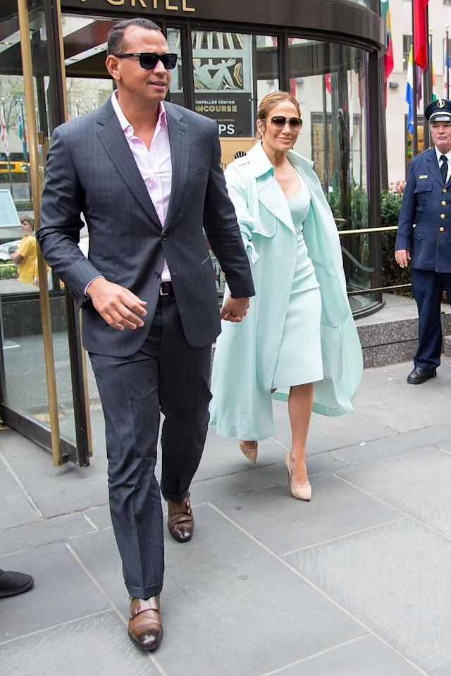 <p>The retired baseball player wore a pale pink shirt to go with J.Lo's light turquoise look. (Photo: Getty Images) </p>