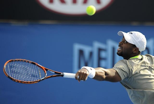 Donald Young of the U.S. hits a backhand return to Andreas Seppi of Italy during their second round match at the Australian Open tennis championship in Melbourne, Australia, Thursday, Jan. 16, 2014. (AP Photo/Andrew Brownbill)