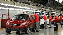 A worker is seen completing final checks on the production line at Nissan car plant in Sunderland, northern England, June 24, 2010. REUTERS/Nigel Roddis/File photo