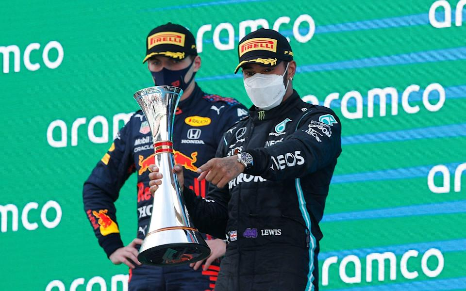 Lewis Hamilton charges past Max Verstappen to claim fifth consecutive Spanish GP win - REUTERS