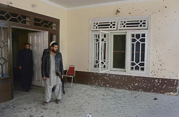 An Afghan man inspects the site of a suicide bombing at the home of a prominent politician in Jalalabad on January 17, 2016 (AFP Photo/Noorullah Shirzada)