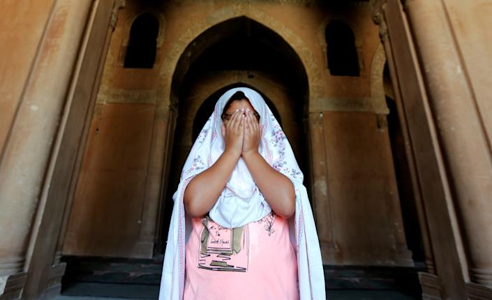 A girl prays during the first Friday of the holy month of Ramadan at Ibn Tulun Mosque in old Cairo, Egypt June 2, 2017. REUTERS/Amr Abdallah Dalsh
