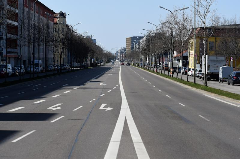 28 March 2020, Bavaria, Munich: Hardly any traffic is visible on Landsbergerstraße in the direction out of town. Due to the corona crisis, exit restrictions are currently in effect. Accumulations of more than two people are prohibited nationwide. Photo: Felix Hörhager/dpa (Photo by Felix Hörhager/picture alliance via Getty Images)