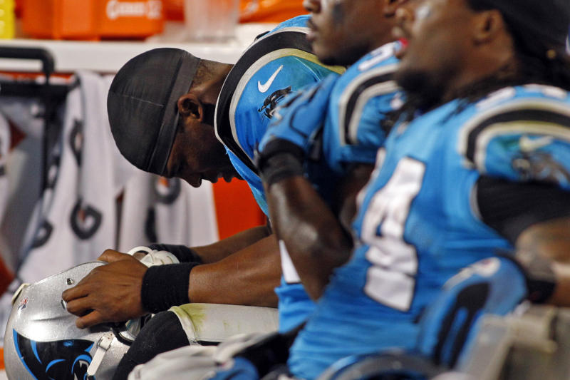 Carolina Panthers quarterback Cam Newton lowers his head while sitting on the bench after an interception against the New York Giants during the third quarter of an NFL football game in Charlotte, N.C., Thursday, Sept. 20, 2012. The Giants won 36-7. (AP Photo/Chuck Burton)