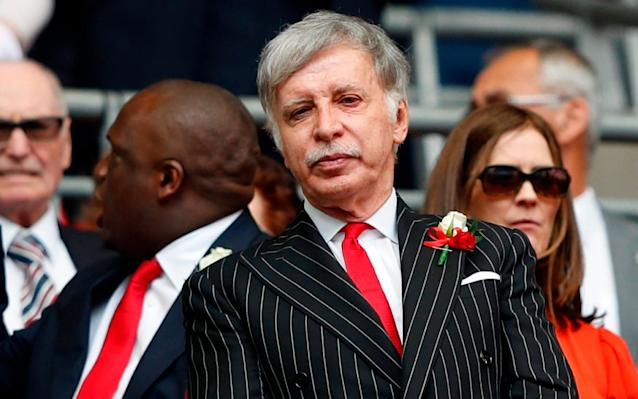 Stan Kroenke pictured in 2017 attending an Arsenal match - AFP