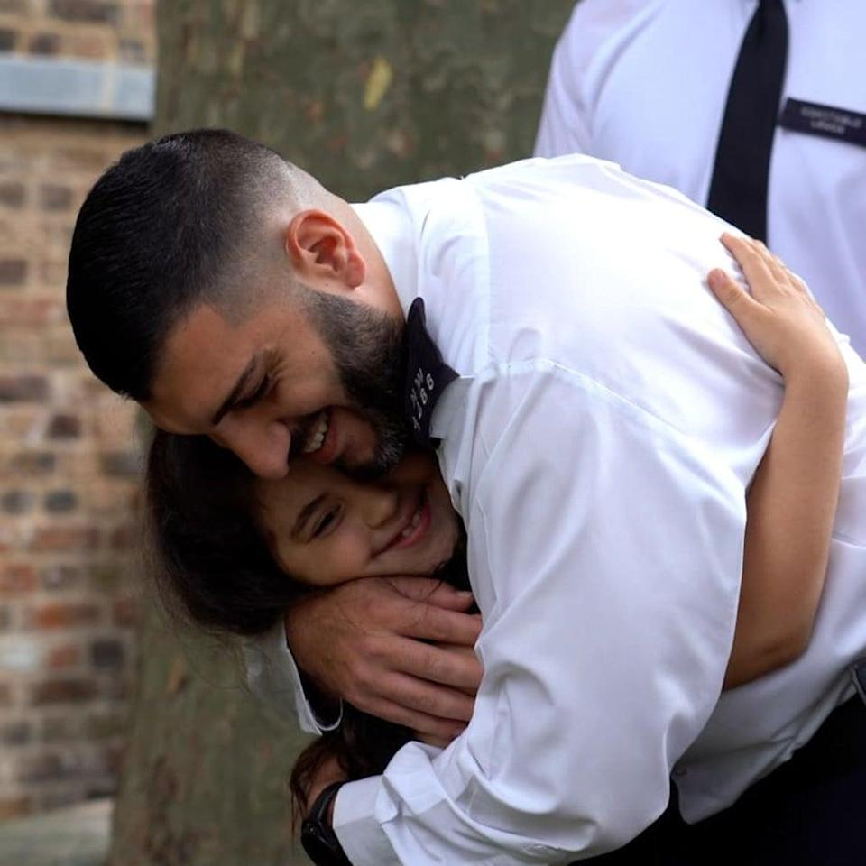 Seven year old Noura was re-united with police officers who saved her life.  (Met police)