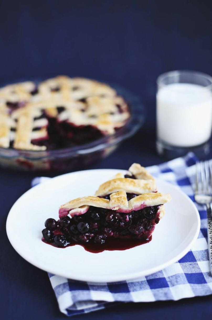 "<p>Tart blueberries and tangy lemon work together to make this pie something special. A large helping of cold whipped cream or vanilla ice cream will make this dessert a fan favorite.</p> <p><strong>Get the recipe:</strong> <a href=""https://abeautifulmess.com/zesty-blueberry-pie/"" class=""link rapid-noclick-resp"" rel=""nofollow noopener"" target=""_blank"" data-ylk=""slk:zesty blueberry pie"">zesty blueberry pie</a></p>"
