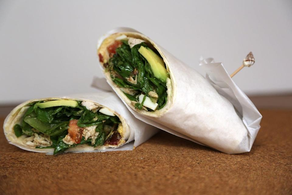 <p>Salad fans don't have to be out of luck when traveling. Toss the greens and other ingredients of this famous salad, then wrap everything up in a tortilla for a Cobb salad wrap recipe that you'll want to keep around forever. We like to pack the dressing on the side and dip the wrap into it to avoid soggy lettuce.</p>