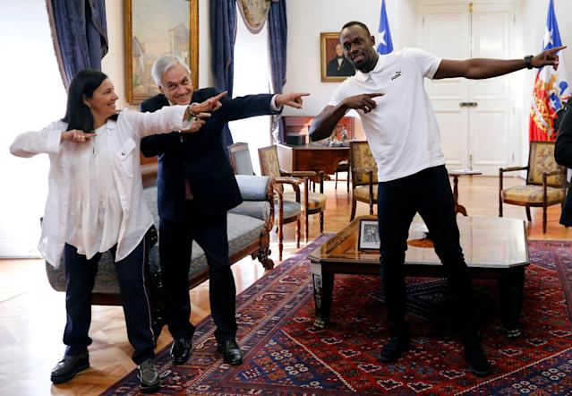Chilean President Sebastian Pinera and the former sprinter Usain Bolt gesture during his visit at the government palace in Santiago, Chile April 1, 2019. REUTERS/Rodrigo Garrido TPX IMAGES OF THE DAY